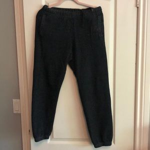 Roots black track pants with two front pockets.
